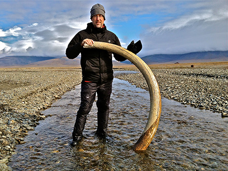 Hampton Sides on Russia's Wrangel Island with 10,000-year-old woolly mammoth tusk